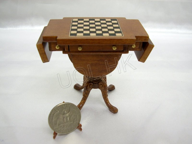 Drop leaf chess table finished in walnut